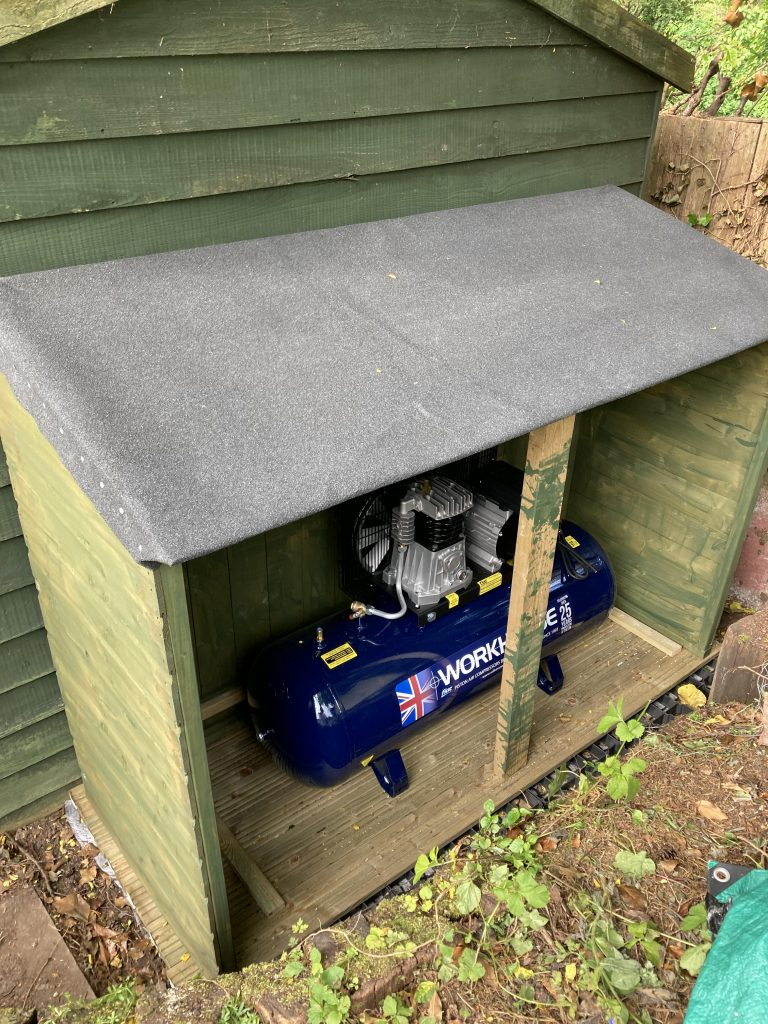 Workhorse compressor at home in shed
